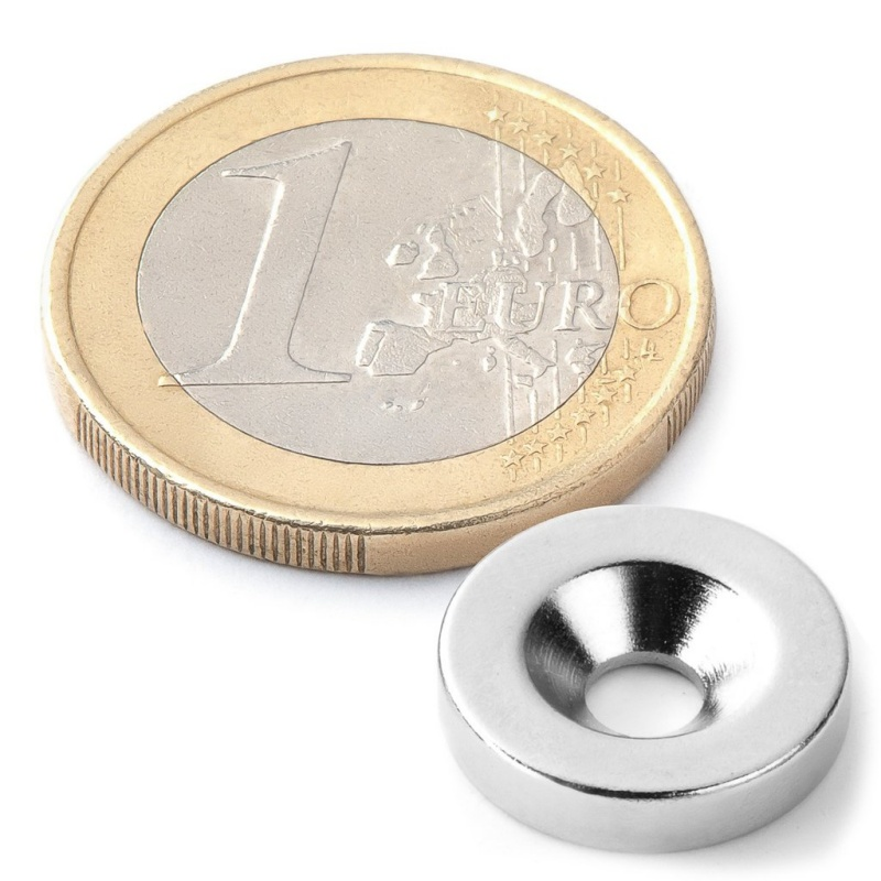 Kruhový magnet s otvorem pro šroub.